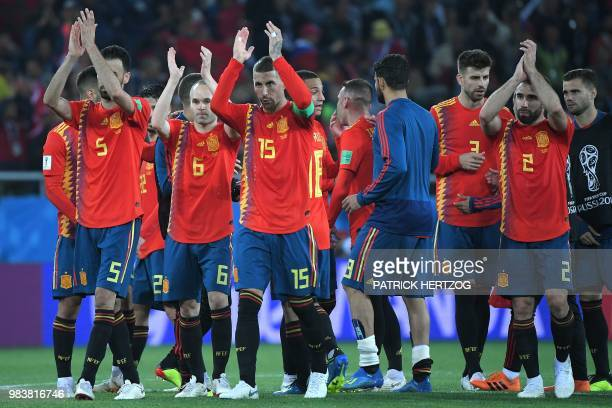 TOPSHOT Spain's players acknowledge the crowd at the end of the Russia 2018 World Cup Group B football match between Spain and Morocco at the...