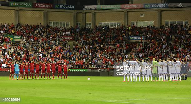 Spain's players and Luxembourg's players pose before the Euro 2016 qualifying football match Spain vs Luxembourg at Las Gaunas stadium in Logrono on...