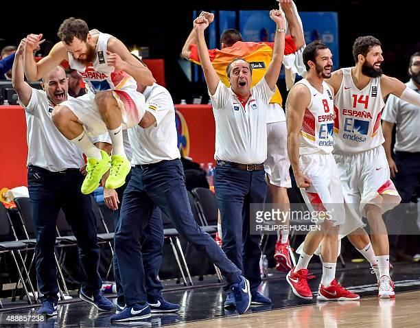 Spain's players and staff celebrate after winning the 2015 EuroBasket semifinal basketball match against France in Lille northern France on September...