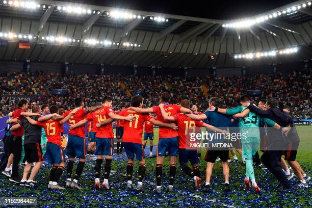 Spain's players and staff celebrate after winning the final match of the UEFA U21 European Football Championships against Germany on June 30 2019 at...
