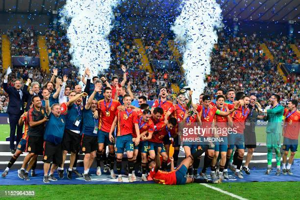 Spain's players and staff celebrate with the winners' trophy after winning the final match of the UEFA U21 European Football Championships against...