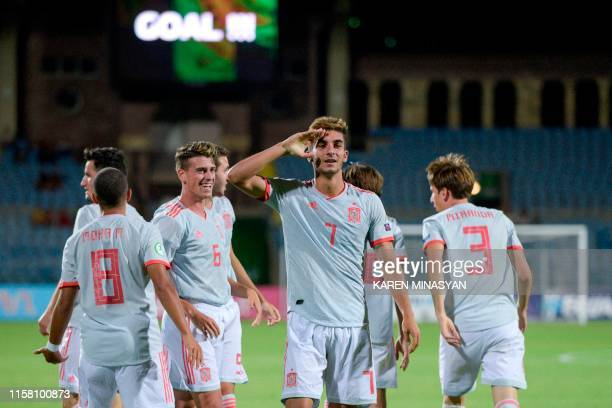 Spain's players celebrate a goal scored by midfielder Ferran Torres during the 2019 UEFA European Under19 Championship final football match between...