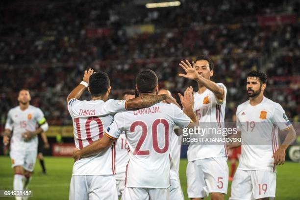 Spain's players celebrate after scoring a goal during the FIFA World Cup 2018 qualification football match between Macedonia and Spain at the Philip...