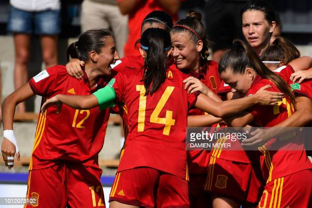 Spain's players celebrate after scoring a goal during the Women's U20 World Cup Group C football match between Paraguay and Spain at the Guy Piriou...