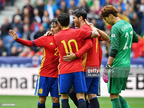Spain's players celebrate after scoring as South Korea's goalkeeper Kim JinHyeon looks on during the international friendly football match of Spain...