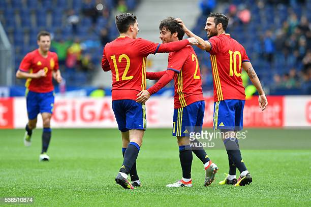 Spain's players celebrate after scoring during the international friendly football match of Spain vs South Korea on June 1 2016 in Salzburg Austria...