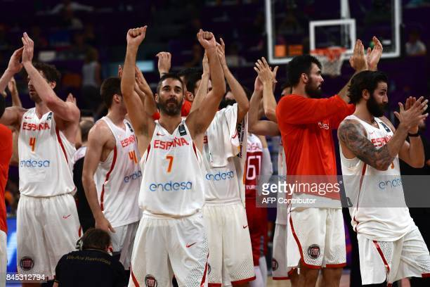 Spain's players celebrate after winning against Turkey at the end of the FIBA Eurobasket 2017 men's round 16 basketball match between Spain and...