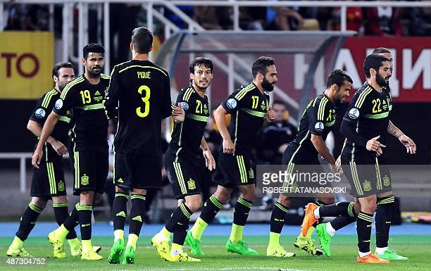 Spain's players celebrate after winning the Euro 2016 Group C qualifying football match between Macedonia and Spain at the Filip II Arena stadium in...
