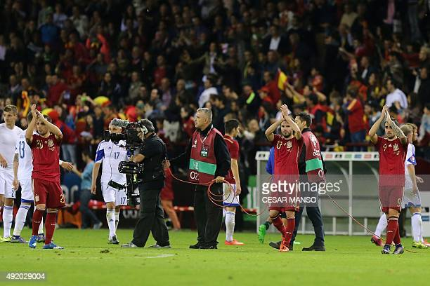 Spain's players celebrate after winning the Euro 2016 qualifying football match Spain vs Luxembourg at Las Gaunas stadium in Logrono on October 9...