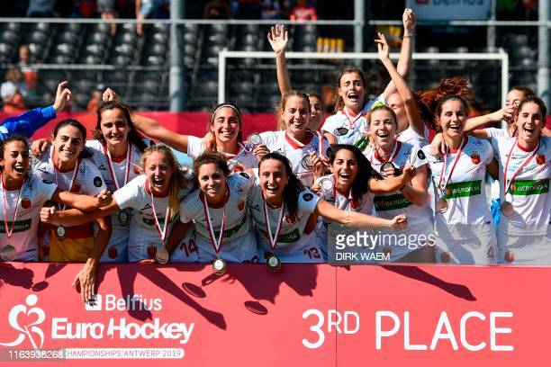 Spain's players celebrate after winning the third place during the EuroHockey European Championships field hockey match against England on August 25...