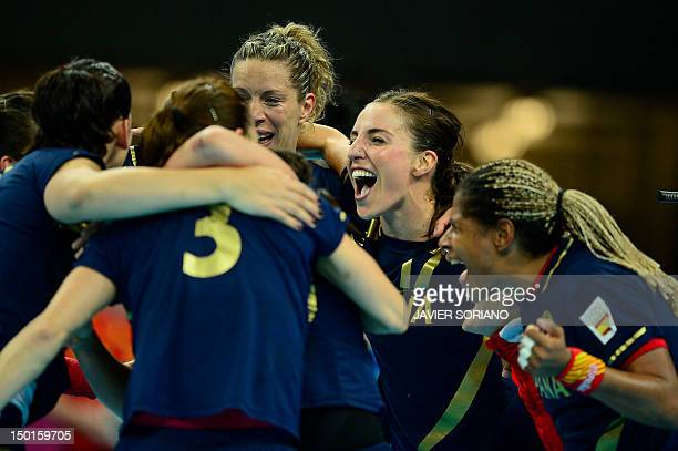 Spain's players celebrate at the end of the women's bronze medal handball match South Korea vs Spain for the London 2012 Olympics Games on August 11...