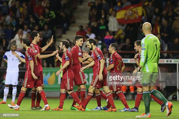 Spain's players celebrate during the Euro 2016 qualifying football match Spain vs Luxembourg at Las Gaunas stadium in Logrono on October 9 2015 AFP...