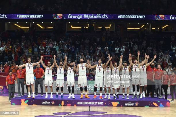 Spain`s players celebrate on the podium with their third placed medals after winning the FIBA Eurobasket 2017 men`s bronze medal basketball match...