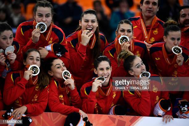 TOPSHOT Spain's players celebrate the silver medal at the Women's Handball World Championship in Kumamoto on December 15 2019