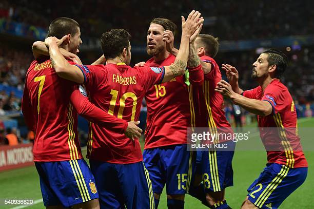 Spain's players celebrate their opening goal during the Euro 2016 group D football match between Spain and Turkey at the Allianz Riviera stadium in...