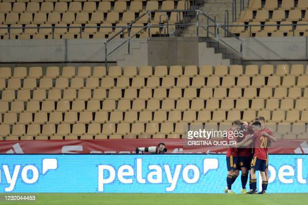 Spain's players celebrate their second goal scored by midfielder Ferran Torres during the FIFA World Cup Qatar 2022 qualification football match...