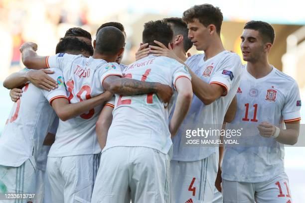 Spain's players celebrate their team's fifth goal, an own goal by Slovakia's midfielder Juraj Kucka during the UEFA EURO 2020 Group E football match...