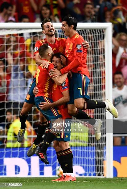 Spain's players celebrate their third goal scored by Spain's forward Mikel Oyarzabal during the UEFA Euro 2020 group F qualifying football match...