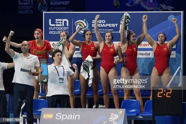 Spain's players celebrate their victory over Hungary at the end of their women's water polo semifinal at the European Water Polo Championships on...