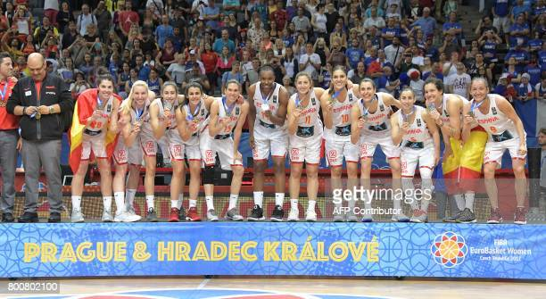 Spain's players celebrate with their medals during the winner's ceremony after winning the FIBA EuroBasket 2017 women's final match between Spain and...