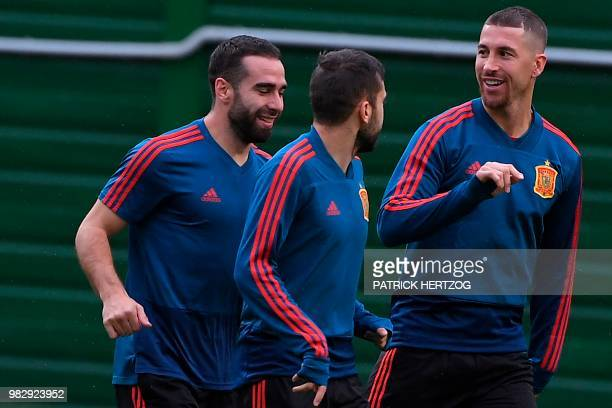 Spain's players including Spain's defender Sergio Ramos and Spain's defender Dani Carvajal take part in a training session at Mirniy Stadium in...