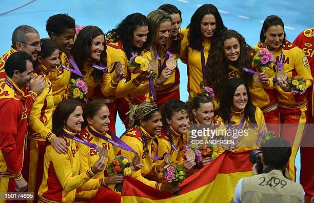 Spain's players pose with their bronze medals after the women's gold medal handball match Norway vs Montenegro for the London 2012 Olympics Games on...