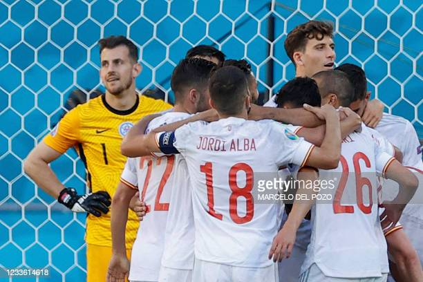 Spain's players react after their team's fifth goal during the UEFA EURO 2020 Group E football match between Slovakia and Spain at La Cartuja Stadium...