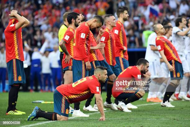 Spain's players react to Russia's victory after the penalty shootout at the end of the Russia 2018 World Cup round of 16 football match between Spain...