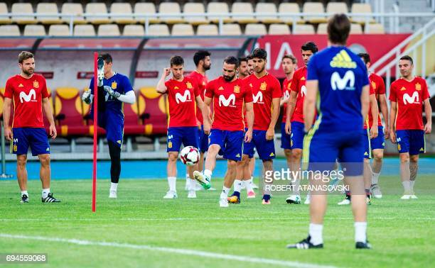 Spain's players take part in a training session in Skopje on June 10 on the eve of the FIFA World Cup 2018 qualification football match between...