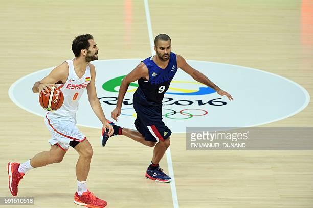 Spain's point guard Jose Manuel Calderon dribbles past France's point guard Tony Parker during a Men's quarterfinal basketball match between Spain...