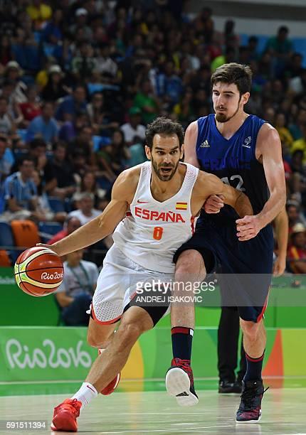 Spain's point guard Jose Manuel Calderon runs past France's guard Nando de Colo during a Men's quarterfinal basketball match between Spain and France...