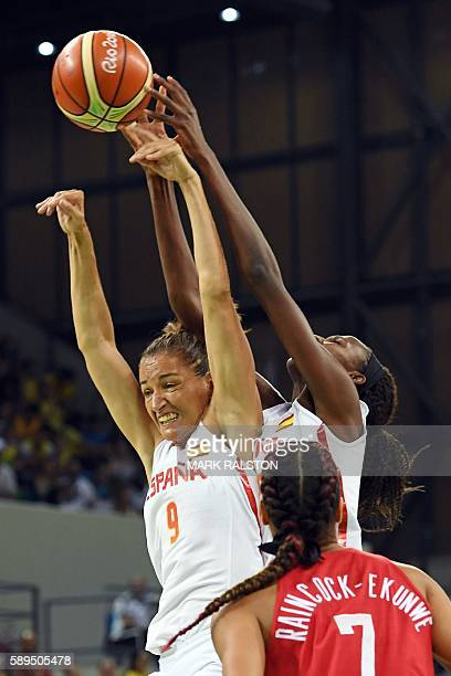 Spain's point guard Laia Palau and Spain's power forward Astou Ndour jump for the ball during a Women's round Group B basketball match between Spain...