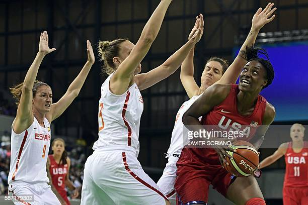 Spain's point guard Laia Palau Spain's centre Lucila Pascua and Spain's power forward Laura Nicholls defends against USA's centre Sylvia Fowles...