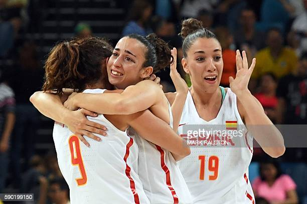 Spain's point guard Laia Palau Spain's point guard Silvia Dominguez and Spain's forward Laura Quevedo celebrate after defeating Turkey during a...