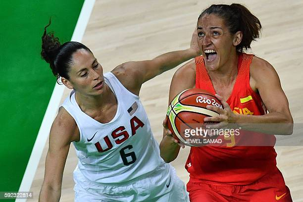 Spain's point guard Laia Palau tries to shoot by USA's guard Sue Bird during a Women's Gold medal basketball match between USA and Spain at the...