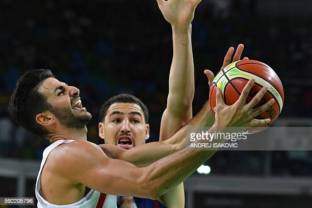 Spain's point guard Ricky Rubio jumps for the basket by USA's guard Klay Thompson during a Men's semifinal basketball match between Spain and USA at...