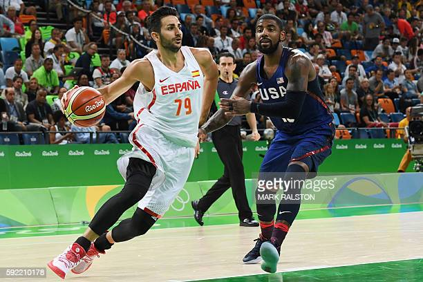 Spain's point guard Ricky Rubio runs past USA's guard Kyrie Irving during a Men's semifinal basketball match between Spain and USA at the Carioca...