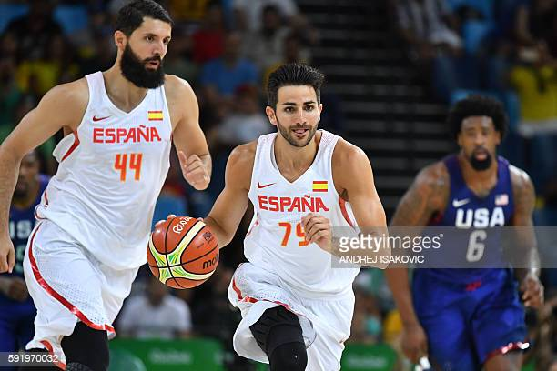 Spain's point guard Ricky Rubio runs with the ball during a Men's semifinal basketball match between Spain and USA at the Carioca Arena 1 in Rio de...