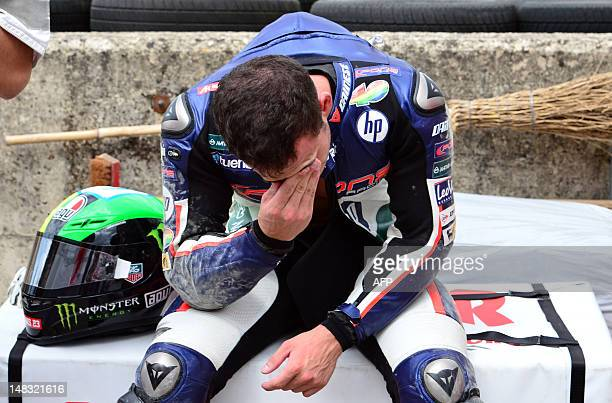 Spain's Pol Espargaro of Pons 40 hp team reacts after he fell off his bike during a Moto2 practice session for the Italian Grand Prix on the Mugello...