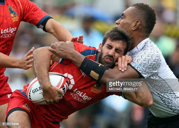 Spain's Pol Pla is tackled by Fiji's Eroni Sau in action during the World Rugby Sevens Series match between Fiji and Spain at Waikato Stadium in...