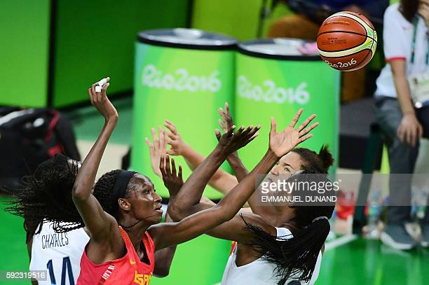 Spain's power forward Astou Ndour jumps for the ball with USA's centre Sylvia Fowles during a Women's Gold medal basketball match between USA and...