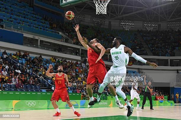Spain's power forward Felipe Reyes and Nigeria's centre Ekene Ibekwe go for a rebound during a Men's round Group B basketball match between Nigeria...