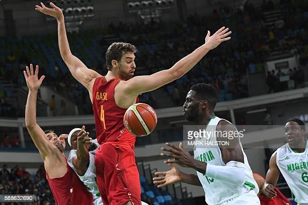 Spain's power forward Felipe Reyes, Nigeria's point guard Josh Akognon, Spain's centre Pau Gasol, Nigeria's centre Ekene Ibekwe and Nigeria's power...