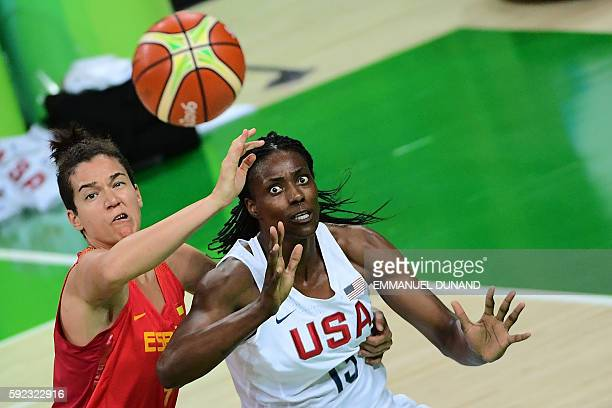 Spain's power forward Laura Nicholls vies with USA's centre Sylvia Fowles during a Women's Gold medal basketball match between USA and Spain at the...