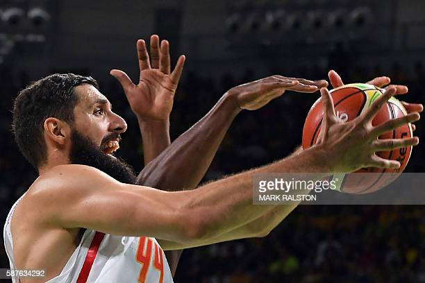 TOPSHOT Spain's power forward Nikola Mirotic goes for a rebound during a Men's round Group B basketball match between Spain and Brazil at the Carioca...