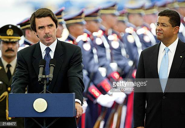 Spain's President of the Government Jose Maria Aznar speaks to the press near by the Salvadorean President Francisco Flores during the welcoming...