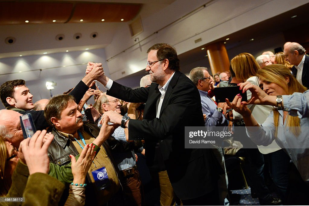 Spain's Prime Minister and President of Partido Popular (People's Party) Mariano Rajoy shakes hands with supporters during the official presentation of the Partido Popular candidates on November 21, 2015 in Barcelona, Spain. Spain's Prime Minister and President of the 'Partido Popular', (People's Party) Mariano Rajoy presented their candidates today in Barcelona ahead of Spain's elections which will take place on December 20.