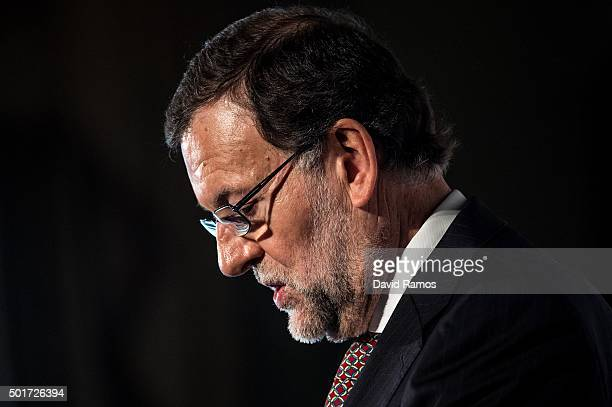 Spain's Prime Minister and President of rightwing Partido Popular Mariano Rajoy delivers a speech during a meeting with businessmen on December 17...