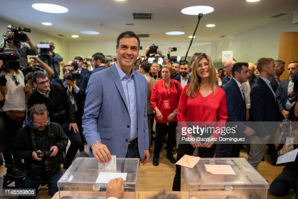 Spain's Prime Minister and Spanish Socialist Workers' Party leader Pedro Sanchez poses for photographers as he cast his vote while his wife Maria...