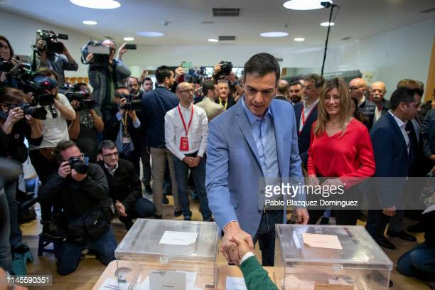 Spain's Prime Minister and Spanish Socialist Workers' Party leader Pedro Sanchez shakes hands after casting his vote at a polling station during the...